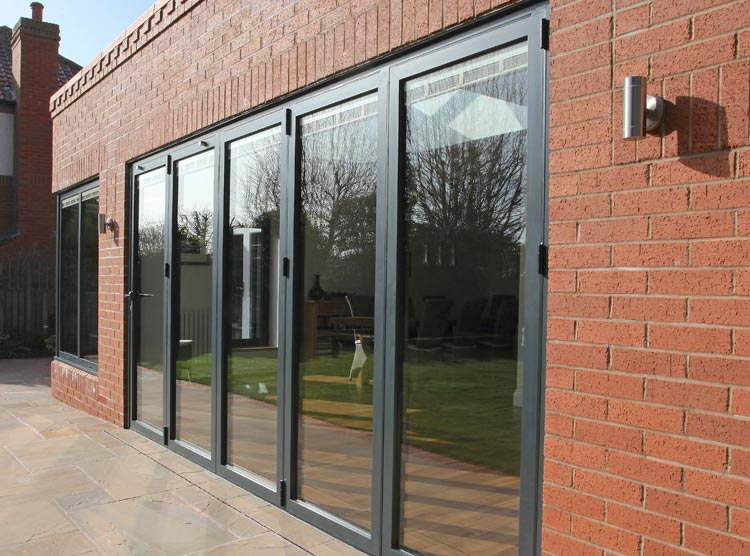 750-home-Alutech-Systems-BF73-bifold-doors-installed-1